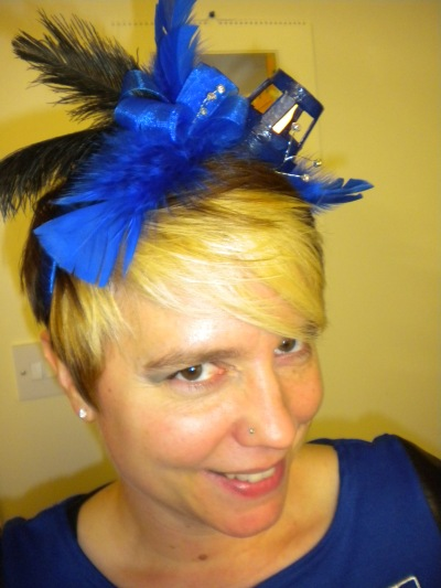The TARDIS isn't the TARDIS without its light, so I made a fascinator that actually lights up (it's one of those battery-powered jack-o-lantern candle lights)!