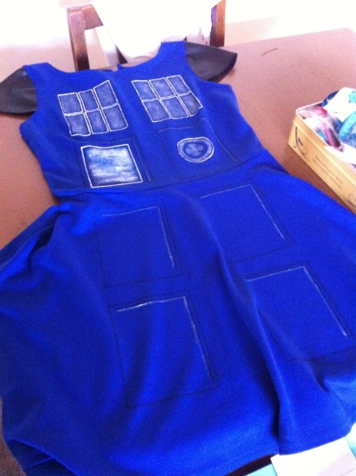 Cheap dress + glow-in-the-dark fabric paint = TARDIS costume!
