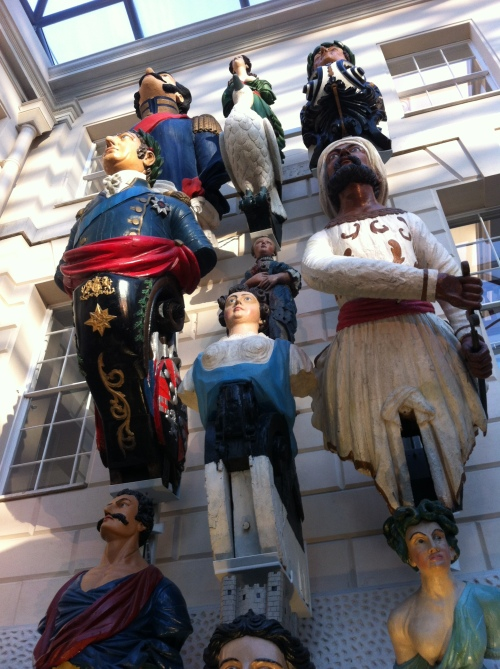 Before we signed in the gift shop, several authors form the anthology did short readings standing below a collection of ship figureheads.